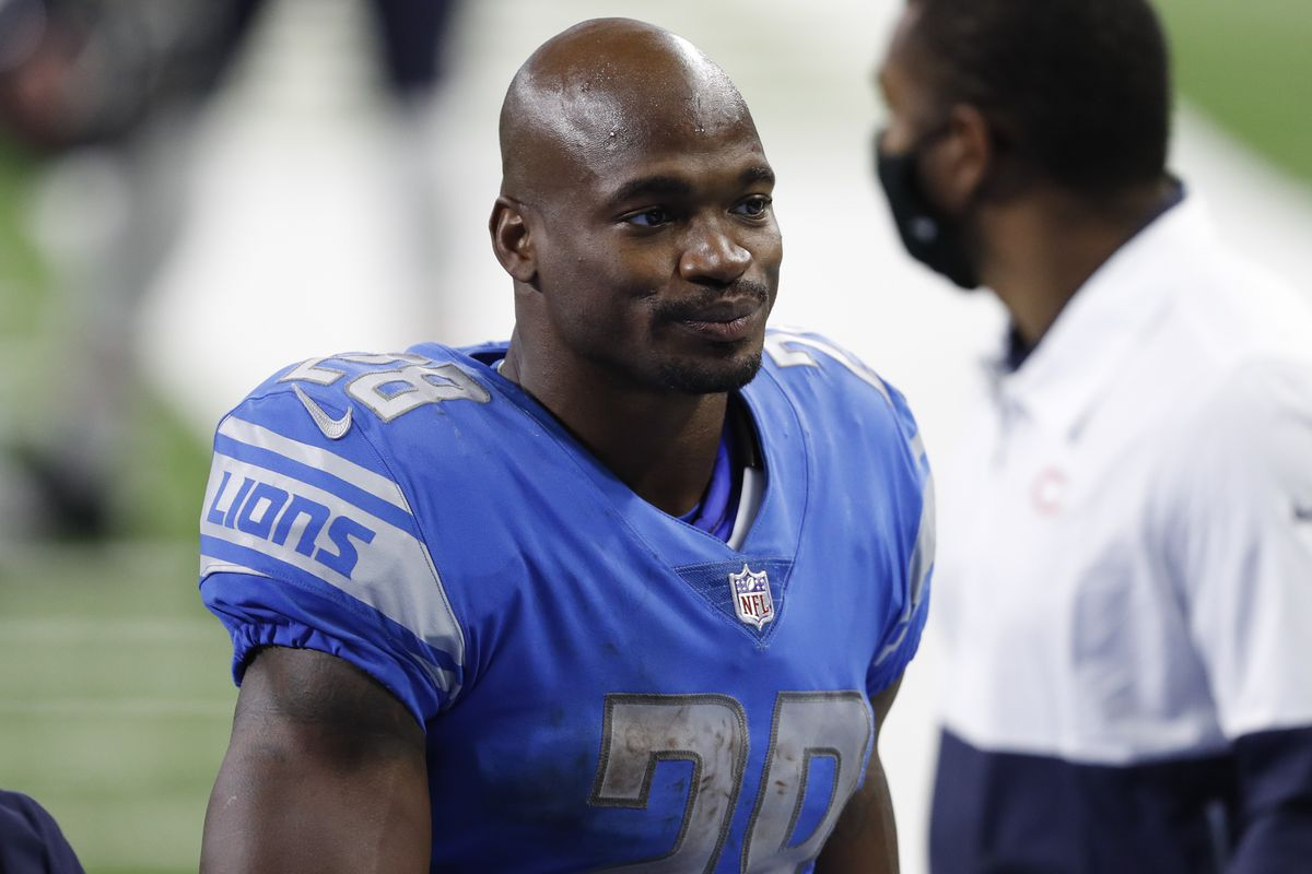 Detroit Lions running back Adrian Peterson walks off the field after the game against the Chicago Bears at Ford Field.
