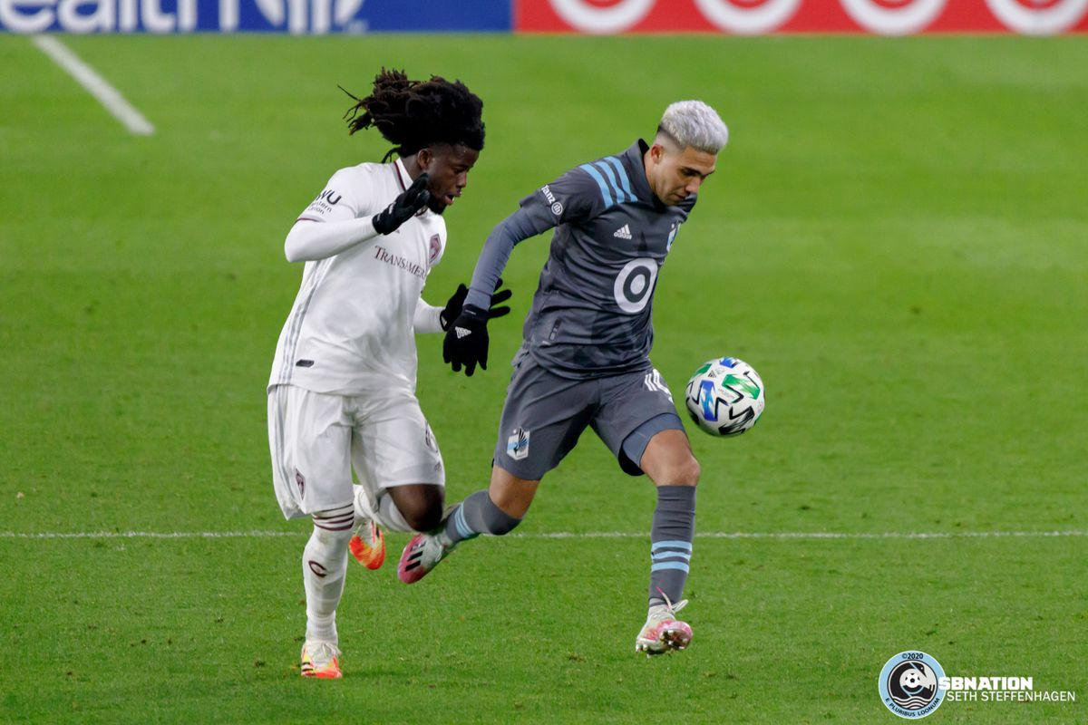 November 22, 2020 - Saint Paul, Minnesota, United States - Colorado Rapids defender Lalas Abubakar (6) chases Minnesota United midfielder Emanuel Reynoso (10) during the first round playoff match at Allianz Field.