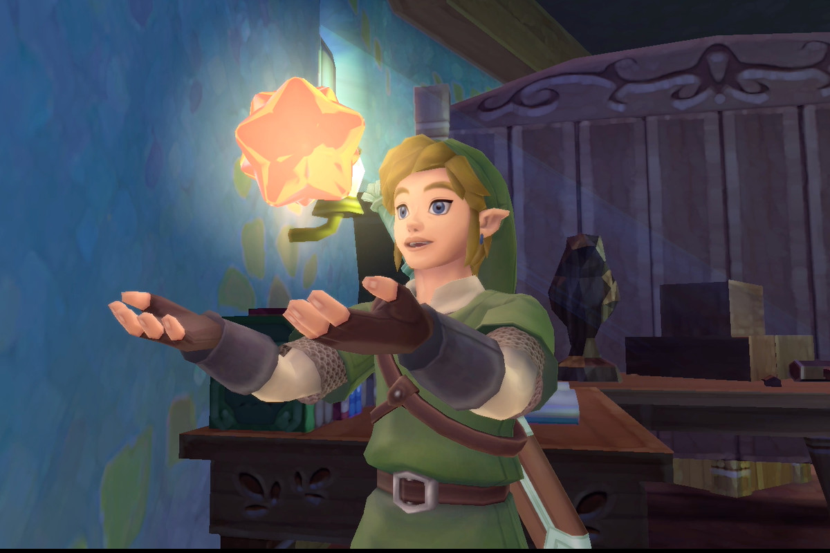 Link holding a Gratitude Crystal in The Legend of Zelda: Skyward Sword HD