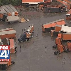 This frame grab provided by KDFW-TV shows tornado damage at the Flying J truck Tuesday, March 3, 2012, in  Lancaster, Texas.  Several reported tornadoes tore through the Dallas area on Tuesday, tossing semis in the air and leaving crumpled tractor trailers strewn along highways and in truck stop parking lots.