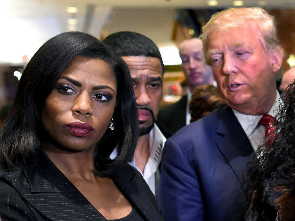 Omarosa Manigault Newman (L) appears alongside Republican presidential hopeful Donald Trump (R) during a press conference in 2015. File Photo by Timothy A. CLARY / AFP/Getty Images