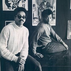 Bobby Rush (left) and Fred Hampton, pose at Illinois Black Panther Party headquarters at 2350 W. Madison. Rush is the party's deputy minister of defense and Hampton is deputy chairman.