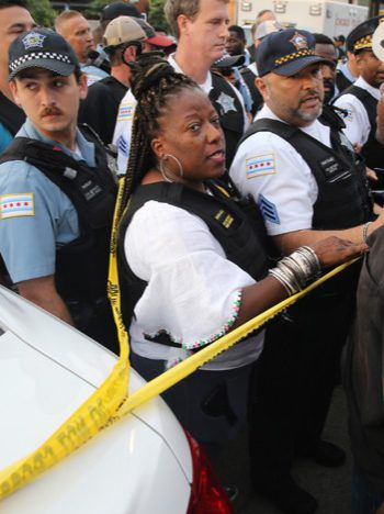 South Chicago District Commander Gloria Hanna, center, at protest over shooting of Harith Augustus. Provided photo.