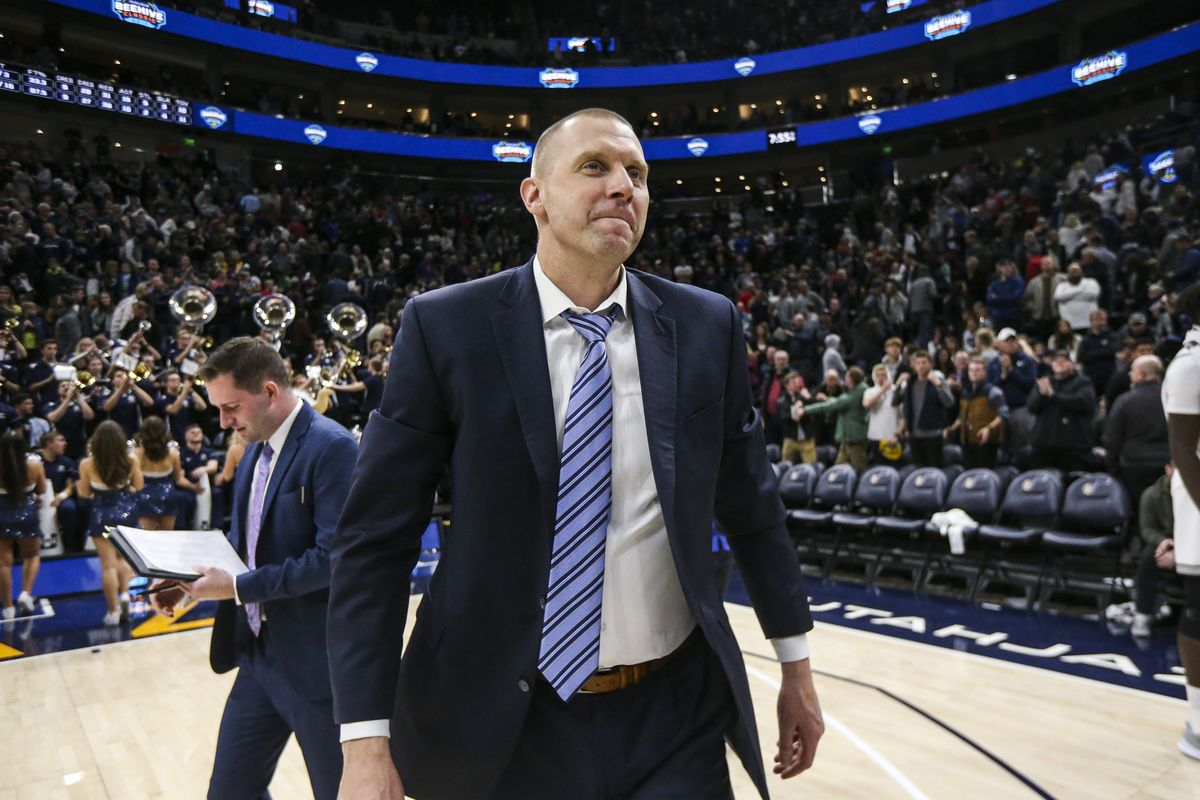 Brigham Young Cougars head coach Mark Pope looks at the BYU student section after defeating the Utah State Aggies 68-64 in the Beehive Classic at Vivint Arena in Salt Lake City on Saturday, Dec. 14, 2019.