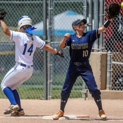 Enterprise's Addison Nelson catches a ball during the 2A softball championship game against Beaver at Spanish Fork Sports Park on Saturday, May 15, 2021. The Enterprise Wolves won 5-2.
