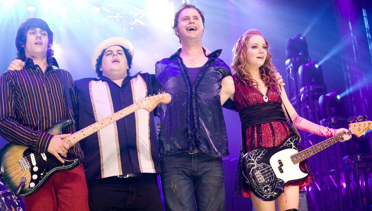 Rainn Wilson, Josh Gad, and their band ADD link arms in The Rocker
