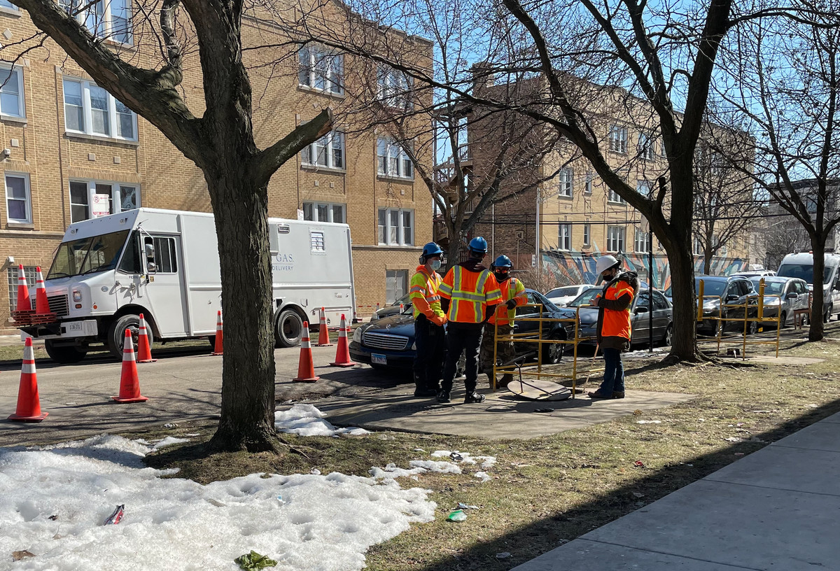 Peoples Gas crews work to fix a natural gas disruption March 3, 2021, in the 2000 block of North St. Louis Avenue.