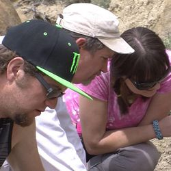 Snow College student Jason Dillingham, left, BLM paleontologist Alan Titus and Snow College student Alli Lancaster unearth a find at a dig at the Grand Staircase-Escalante National Monument April 4, 2014.