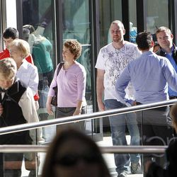Shoppers walk between stores as City Creek Center opens in Salt Lake City, Thursday, March 22, 2012.