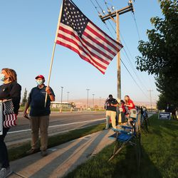 Supporters wait for Vice President Mike Pence's motorcade as he arrives in Salt Lake City on Monday, Oct. 5, 2020.