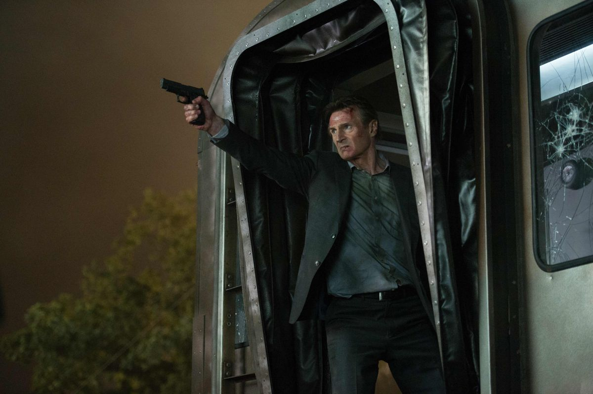 Liam Neeson hanging out of a train car in The Commuter