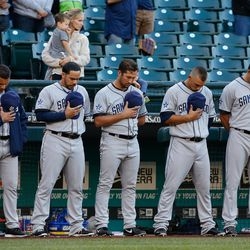 Padres observe a moment of silence before their game against the Mariners at Safeco Field