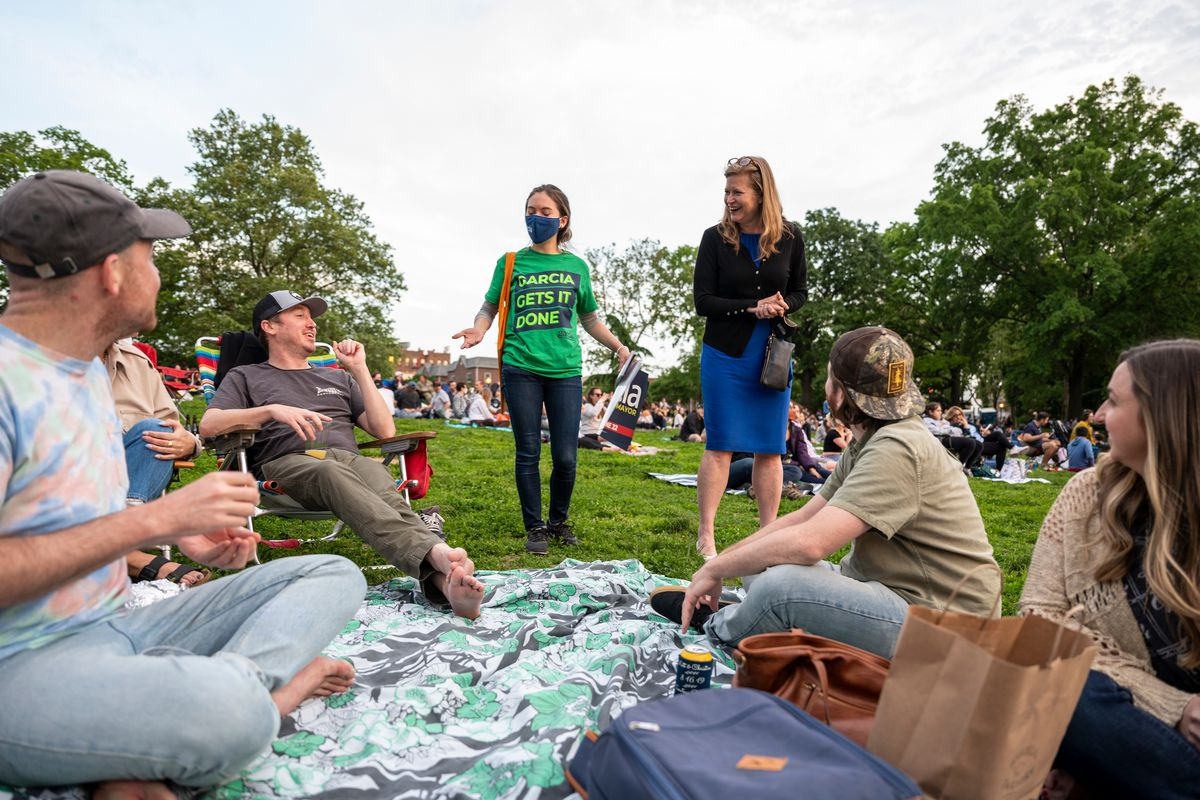 Mayoral candidate Kathryn Garcia speaks with people spreading out in Astoria Park for an outdoor movie, May 21, 2021.
