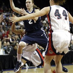 Brigham Young Cougars guard Lexi Eaton (21) drives on Gonzaga Bulldogs forward Kelly Bowen (44)  in the West Coast Conference finals in Las Vegas  Monday, March 5, 2012.  BYU won the title and will advance to the NCAA tournament.