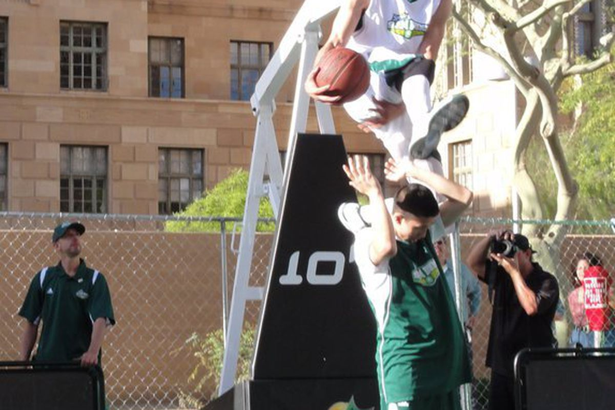"""Kenny """"The Dunk Inventor"""" Dobbs shows off some tremendous ability as he soars for a dunk during the Sprite Slam Dunk Showdown in Los Angeles."""