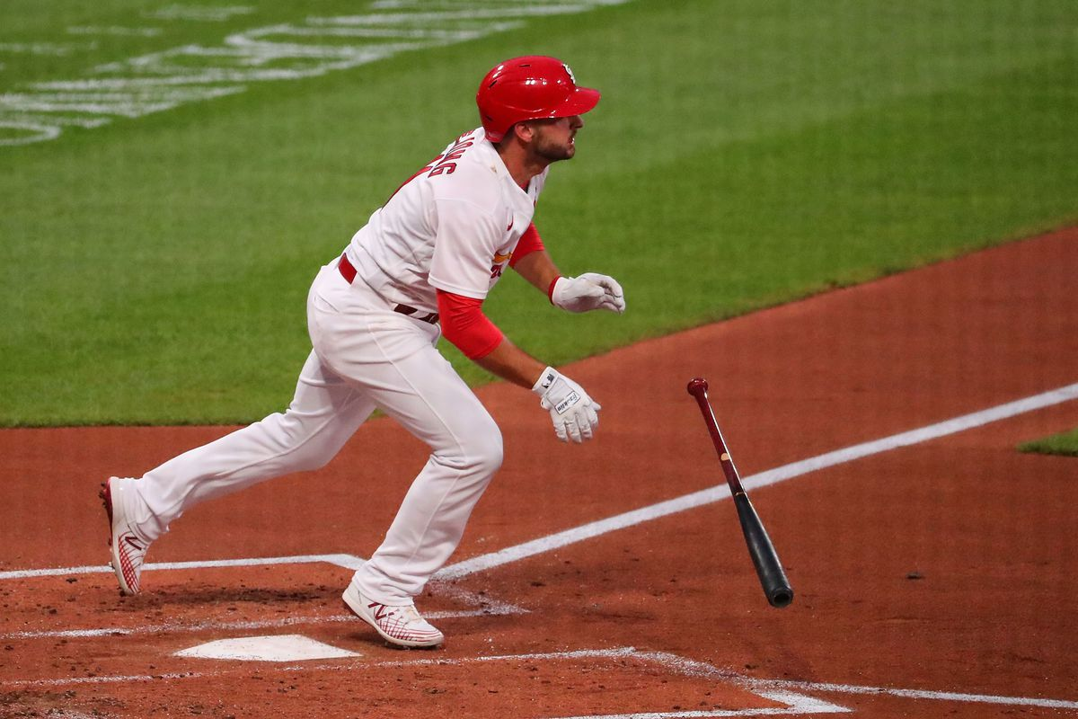 Paul DeJong #11 of the St. Louis Cardinals hits a sacrifice RBI fly ball against the Kansas City Royals in the first inning at Busch Stadium on August 24, 2020 in St Louis, Missouri.
