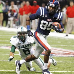 Mississippi wide receiver Ja-Mes Logan (85) runs past Tulane cornerback Lorenzo Doss (6) on his way to scoring a touchdown in the first half of an NCAA college football game in New Orleans, Saturday, Sept. 22, 2012.