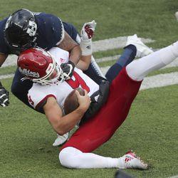 Utah State Aggies linebacker Elijah Shelton (41) sacks Fresno State Bulldogs quarterback Jake Haener (9) in Logan on Saturday, Nov. 14, 2020.