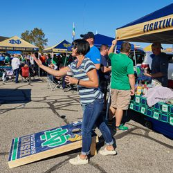 SOUTH BEND, IN - SEPTEMBER 30: A Notre Dame Fighting Irish fan throws a bean bag during a tailgate party prior to the start of the college football game between the Notre Dame Fighting Irish and Miami Redhawks on September 30, 2017, at Notre Dame Stadium in South Bend, IN.