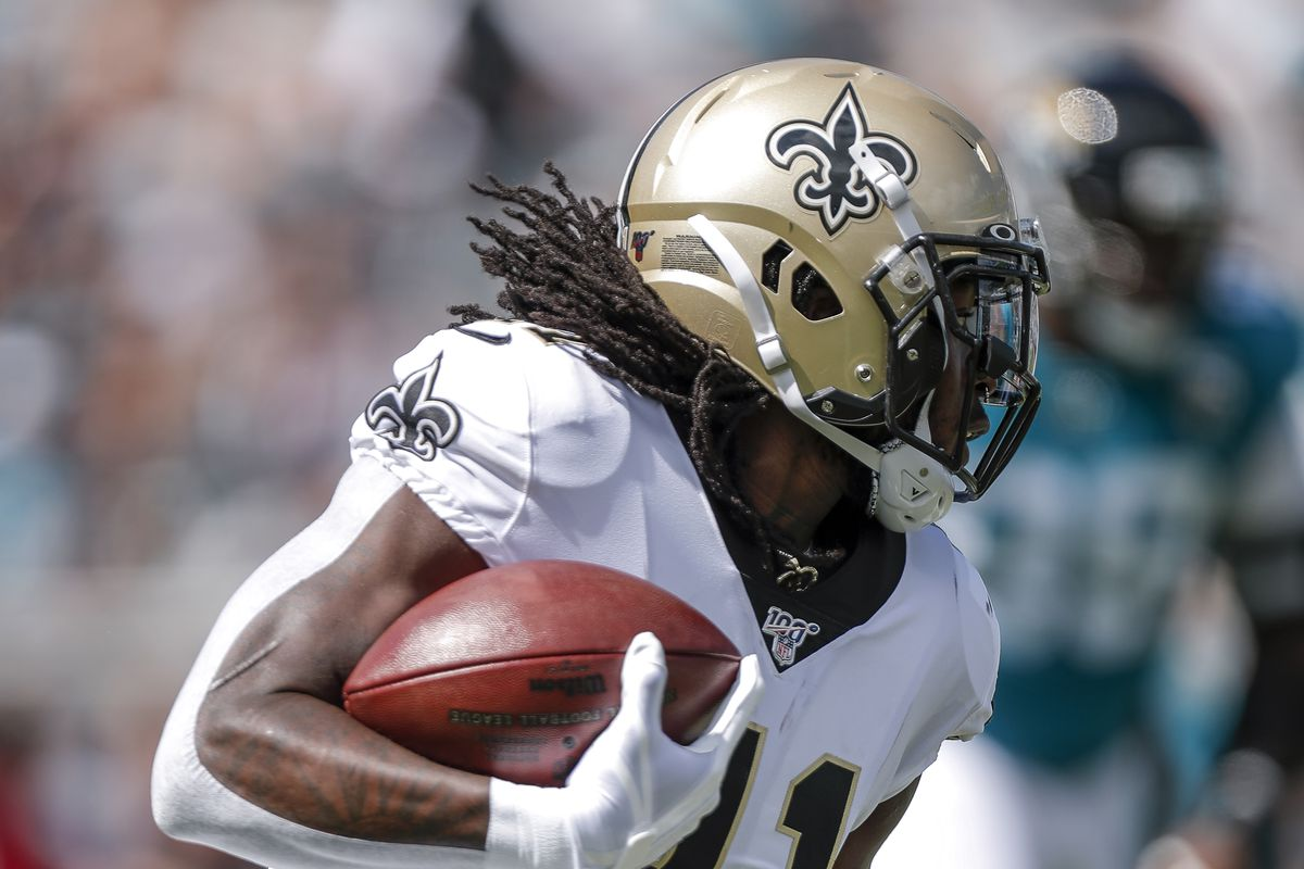 Running back Alvin Kamara of the New Orleans Saints rushes against the Jacksonville Jaguars at TIAA Bank Field on October 13, 2019 in Jacksonville, Florida.