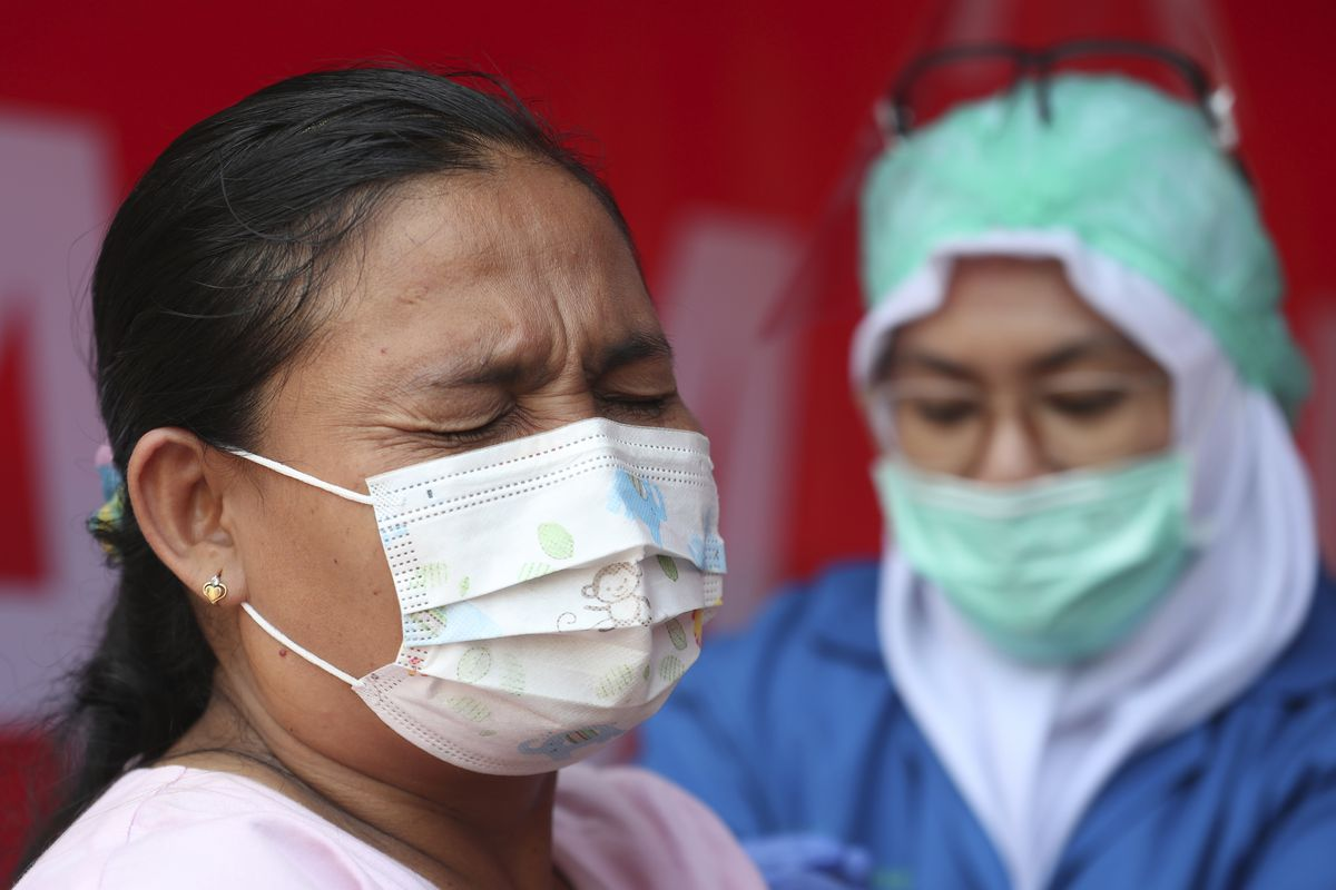 A woman receives the AstraZeneca vaccine in Jakarta, Indonesia.