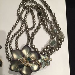 Pearl and flower necklace, $225