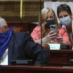 Rep. Candice Pierucci, R-Herriman, center, and Rep. Marsha Judkins, R-Provo, take a selfie as they attend a special session of the Legislature in the House of Representatives to deal with myriad COVID-19 budget changes at the Capitol in Salt Lake City on Thursday, June 18, 2020.