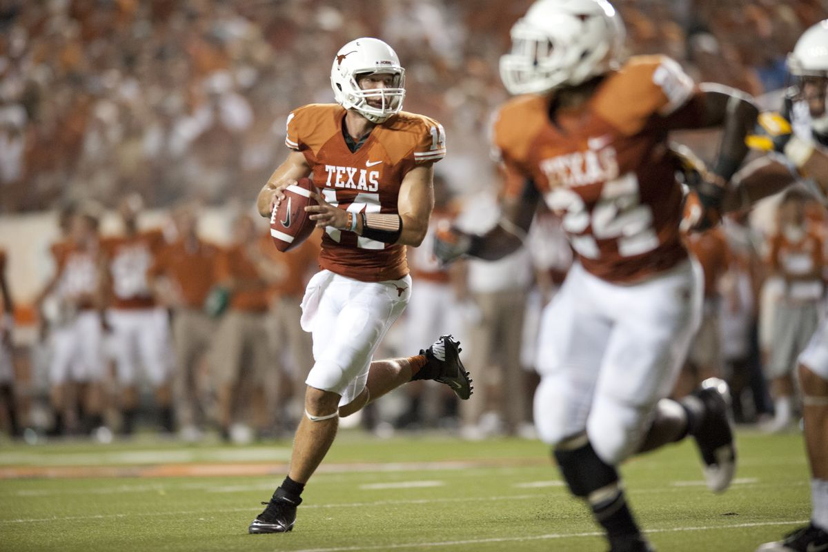 AUSTIN, TX - SEPTEMBER 1: David Ash #14 of the Texas Longhorns throws a pass against the Wyoming Cowboys on September 1, 2012 at Darrell K Royal-Texas Memorial Stadium in Austin, Texas.  (Photo by Cooper Neill/Getty Images)