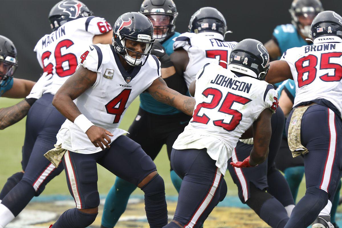 Houston Texans running back Duke Johnson takes a handoff from quarterback Deshaun Watson against the Jacksonville Jaguars during the second half at TIAA Bank Field.