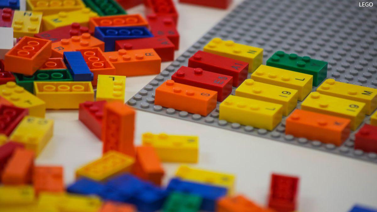 LEGO bricks on gray grid