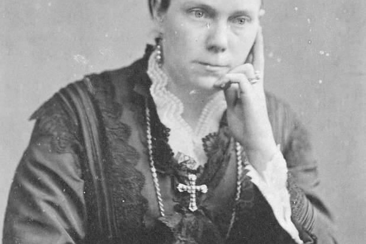Amelia Young, wife of President Brigham Young, wears a cross in this photograph taken in 1895. Harriet Amelia Folsom Young was a plural wife of LDS Church president Brigham Young, married in 1863.
