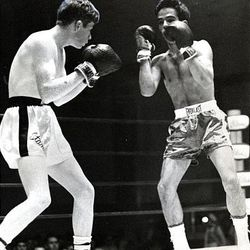 Utah's Danny Lopez, left, stalks Colorado's Dan Hermosillo in a 119-pound championship battle in February 1970. Lopez won by a knockout and was voted the most outstanding boxer in the regional Golden Gloves. Although Lopez, now 57, will be inducted into the Hall of Fame June 13, he works a construction job to support his family financially.