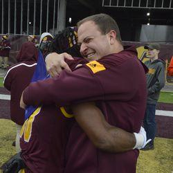 Kalil Pimpleton embraces CMU director of player personnel Albert Karschnia during post-game celebrations.