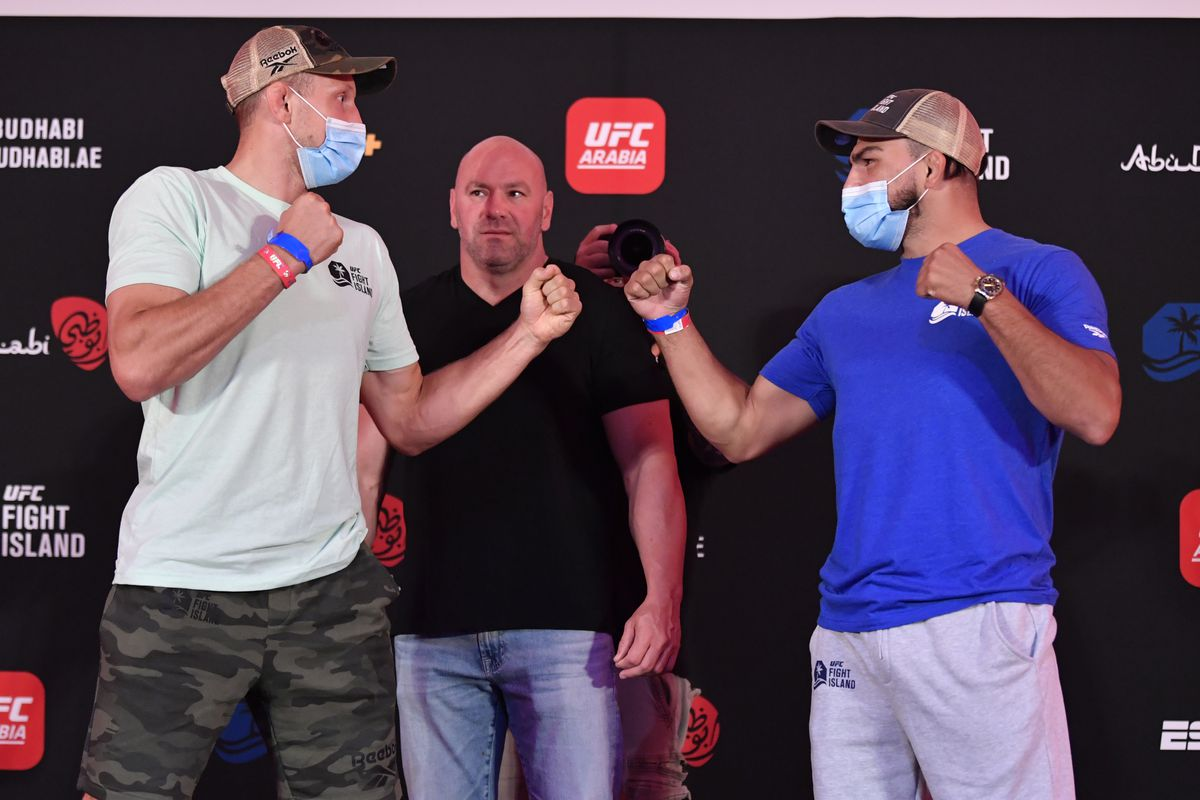 Opponents Jack Hermansson of Sweden and Kelvin Gastelum face off during the UFC Fight Night weigh-in inside Flash Forum on UFC Fight Island on July 17, 2020 in Yas Island, Abu Dhabi, United Arab Emirates.