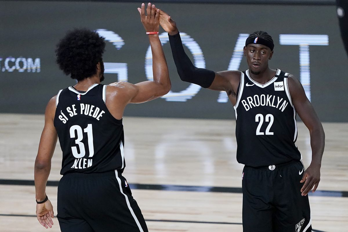 Brooklyn Nets' Jarrett Allen and Caris LeVert react after a play against the Sacramento Kings during the first half of an NBA basketball game at The Arena at ESPN Wide World Of Sports Complex on August 7, 2020 in Lake Buena Vista, Florida.