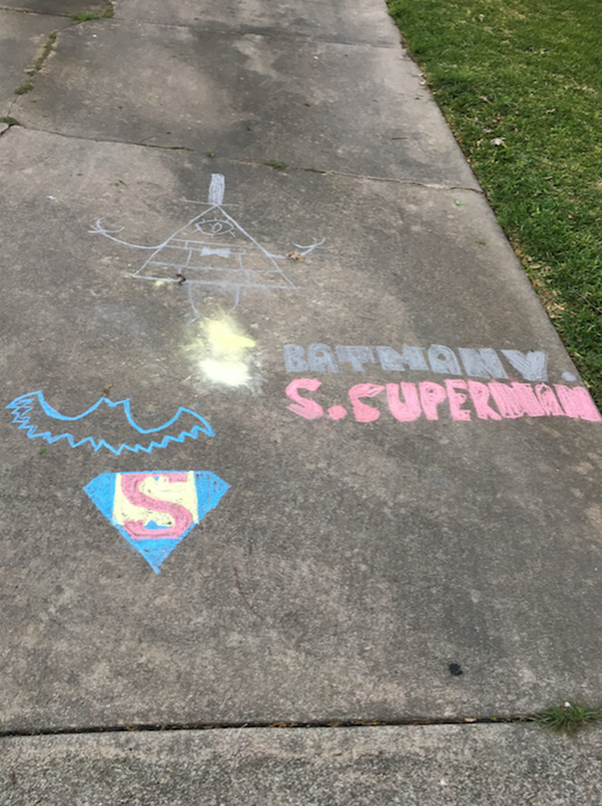 Batman v supermans success as explained by a childs chalk and took a walk around my neighborhood sure enough the universe presented me with what i sought etched onto the driveway of a neighbors home was biocorpaavc Images