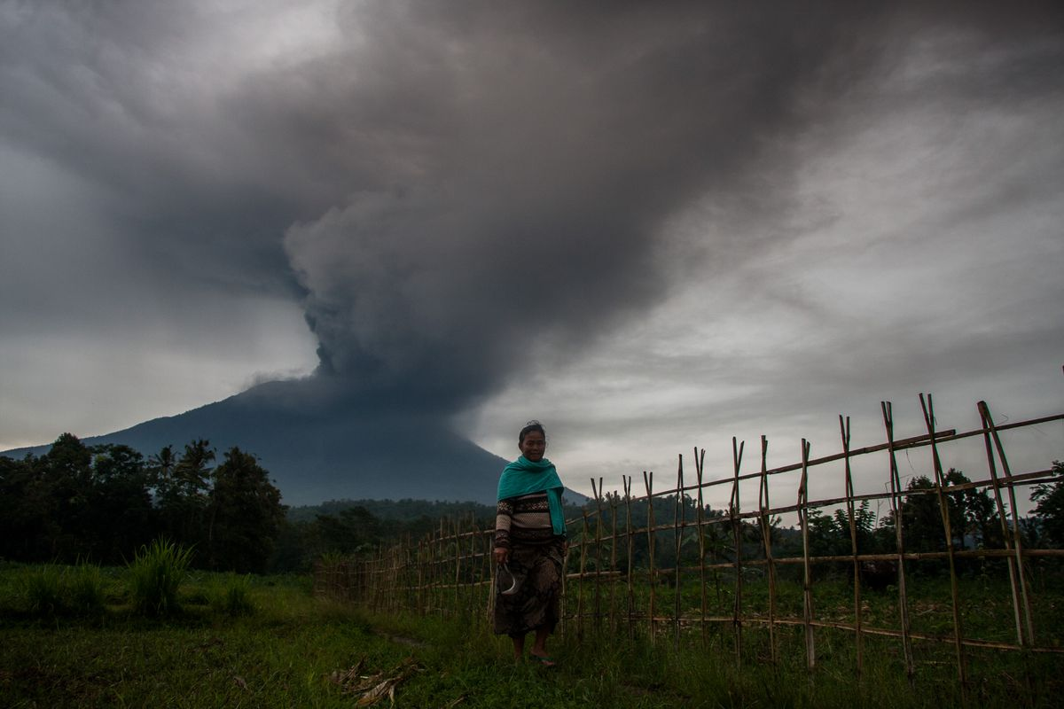 General view of Mount Agung during an eruption seen from Kubu sub-district in Karangasem Regency, on Indonesia's resort island of Bali on November 26, 2017. Mount Agung belched smoke as high as 1,500 metres above its summit, sparking an exodus from settlements near the mountain. (Photo by Muhammad Fauzy/NurPhoto via Getty Images)