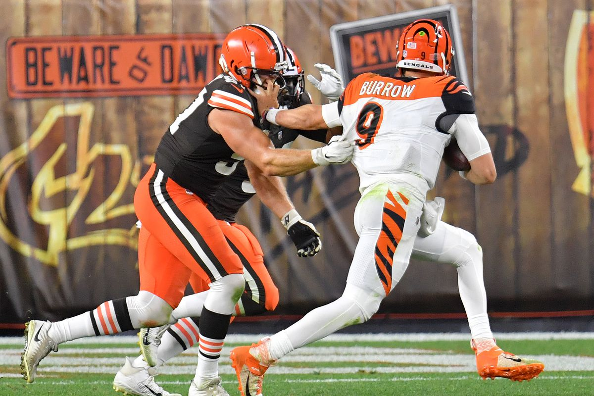 Joe Burrow of the Cincinnati Bengals sacked by Porter Gustin and B.J. Goodson of the Cleveland Browns during the second half at FirstEnergy Stadium on September 17, 2020 in Cleveland, Ohio.