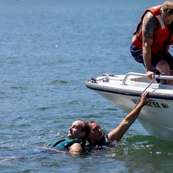 Rashelle Johnson, a firefighter paramedic from Weber Fire District, pulls David Francis, a firefighter pretending to be the victim of a boating accident, toward a rescue boat while training on water rescue skills at Pineview Reservoir near Huntsville, Weber County, on Monday, June 28, 2021.