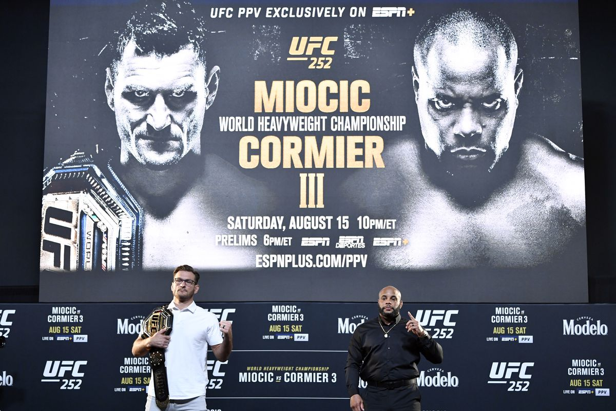 Opponents Stipe Miocic and Daniel Cormier pose for photos during the UFC 252 press conference at UFC APEX on August 13, 2020 in Las Vegas, Nevada.