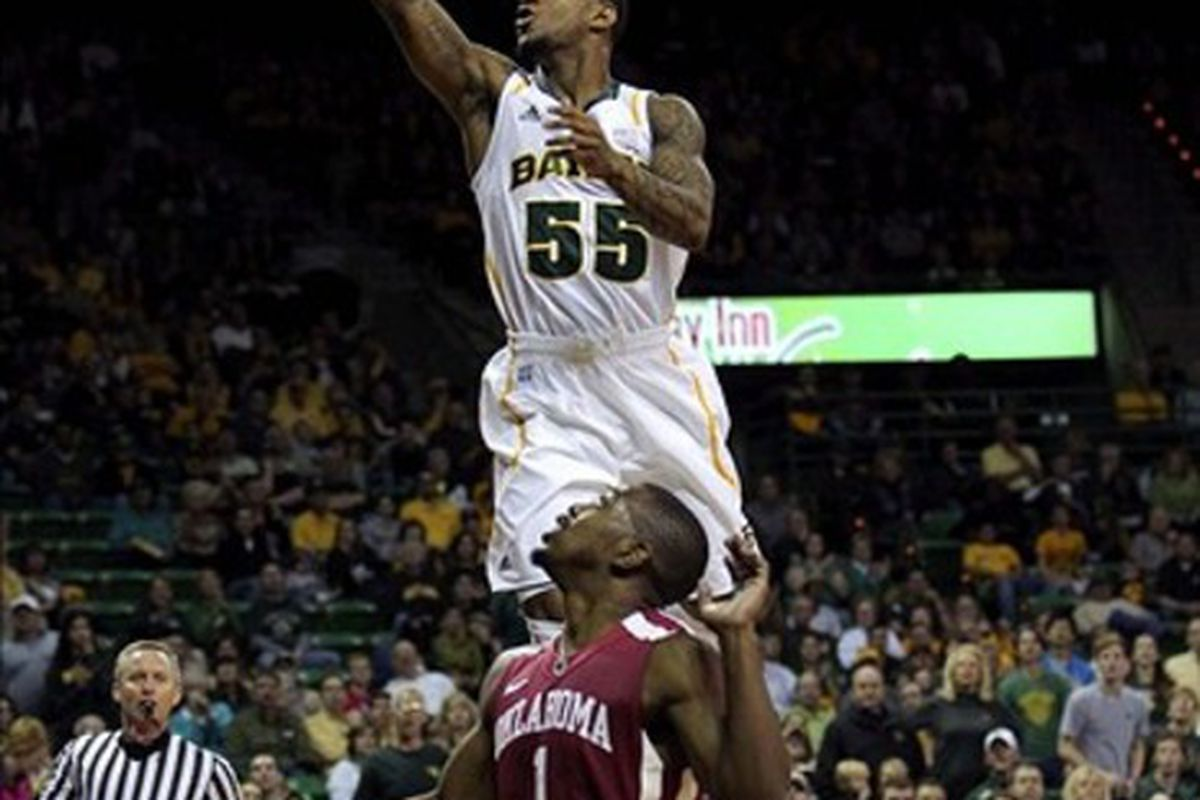 Feb 25, 2012; Waco, TX, USA; Baylor Bears guard Pierre Jackson (55) takes a shot over Oklahoma Sooners guard Sam Grooms (1) during the first half at the Ferrell Center.  Mandatory Credit: Kevin Jairaj-US PRESSWIRE