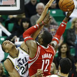 Utah Jazz's center Rudy Gobert (27) disrupts the shot attempt of Houston's Dwight Howard as the Jazz and the Rockets play Saturday, Nov. 2, 2013 in Energy Solutions arena.