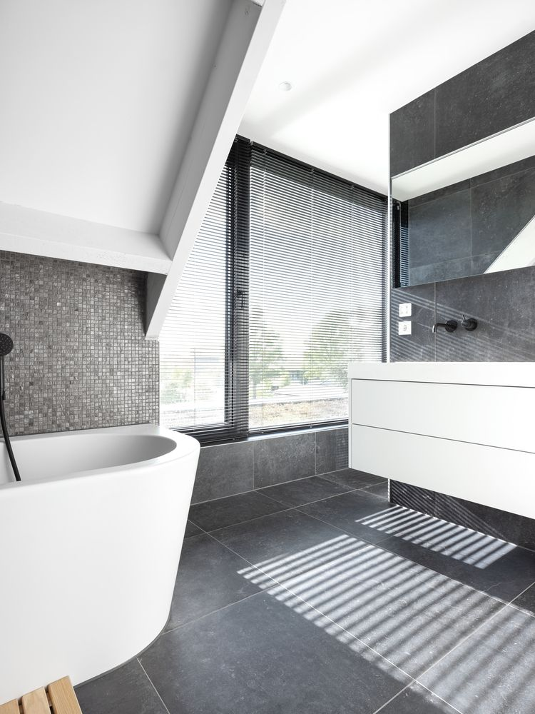 Bathroom swathed in gray tile