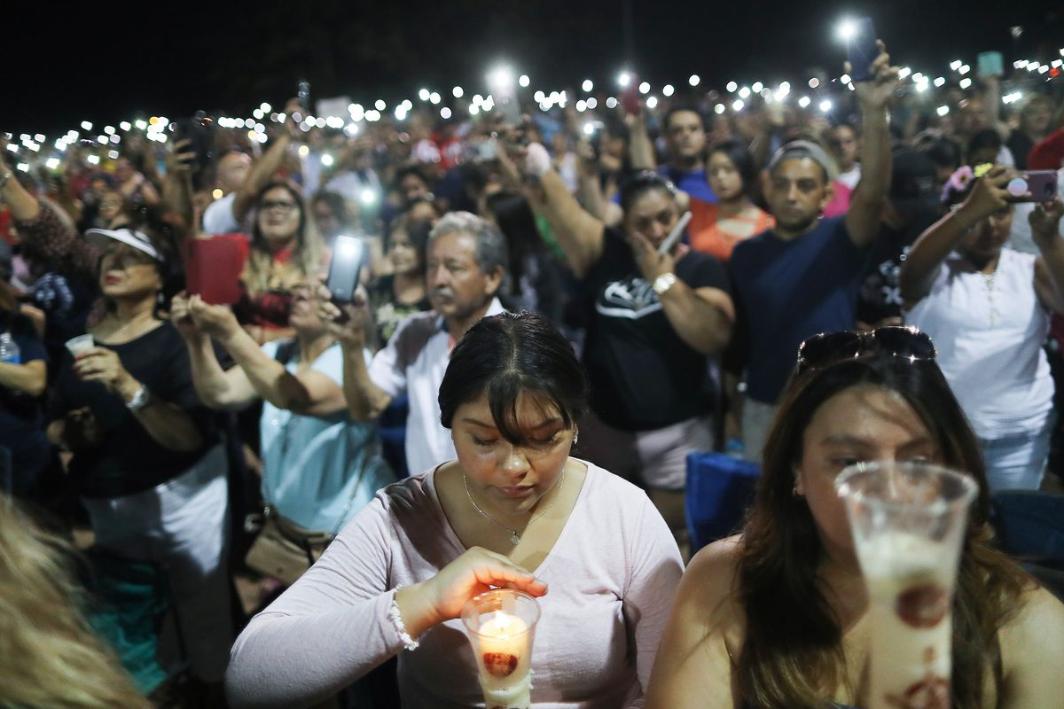 A large group of El Paso residents gather for a candlelight vigil.