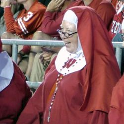 The Badger Nuns, Wisconsin fans who dress up as nuns for games, talk with a security guard during Wisconsin's game against Utah State on Friday, Sept. 1, 2017, at Camp Randall Stadium in Madison, Wisconsin.