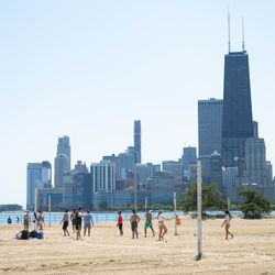 People play volleyball at North Avenue Beach on July 24, 2019.