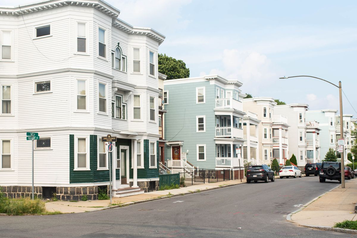 A row of three-story houses close together.