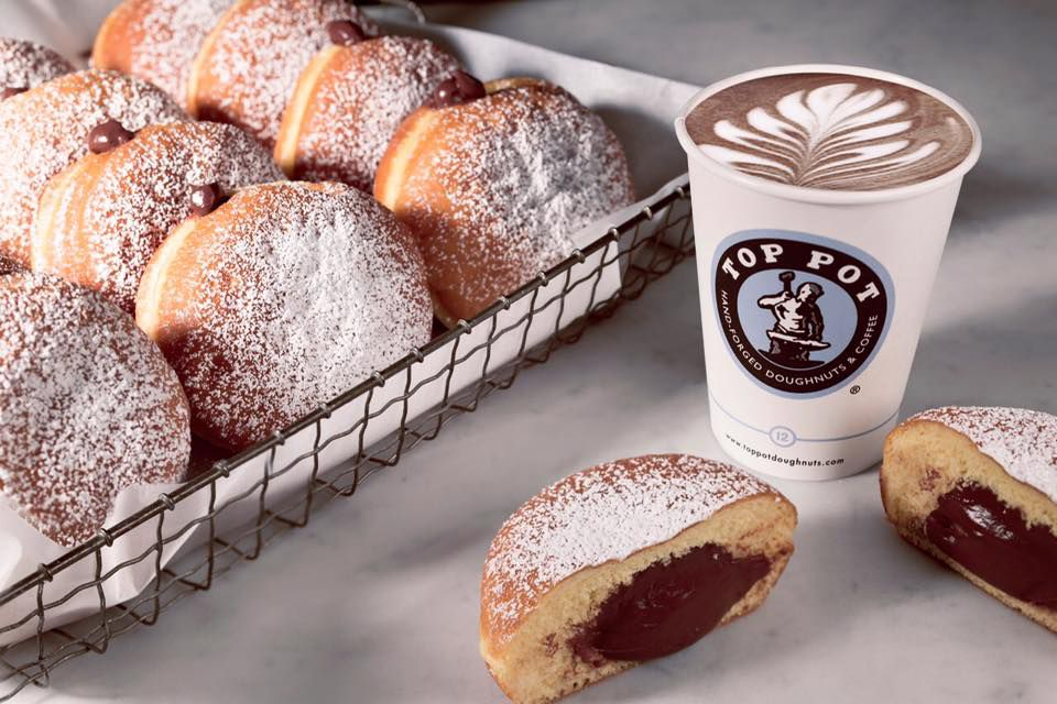 Pictured: Top Pot's jelly-filled doughnuts, along with an artful latte.