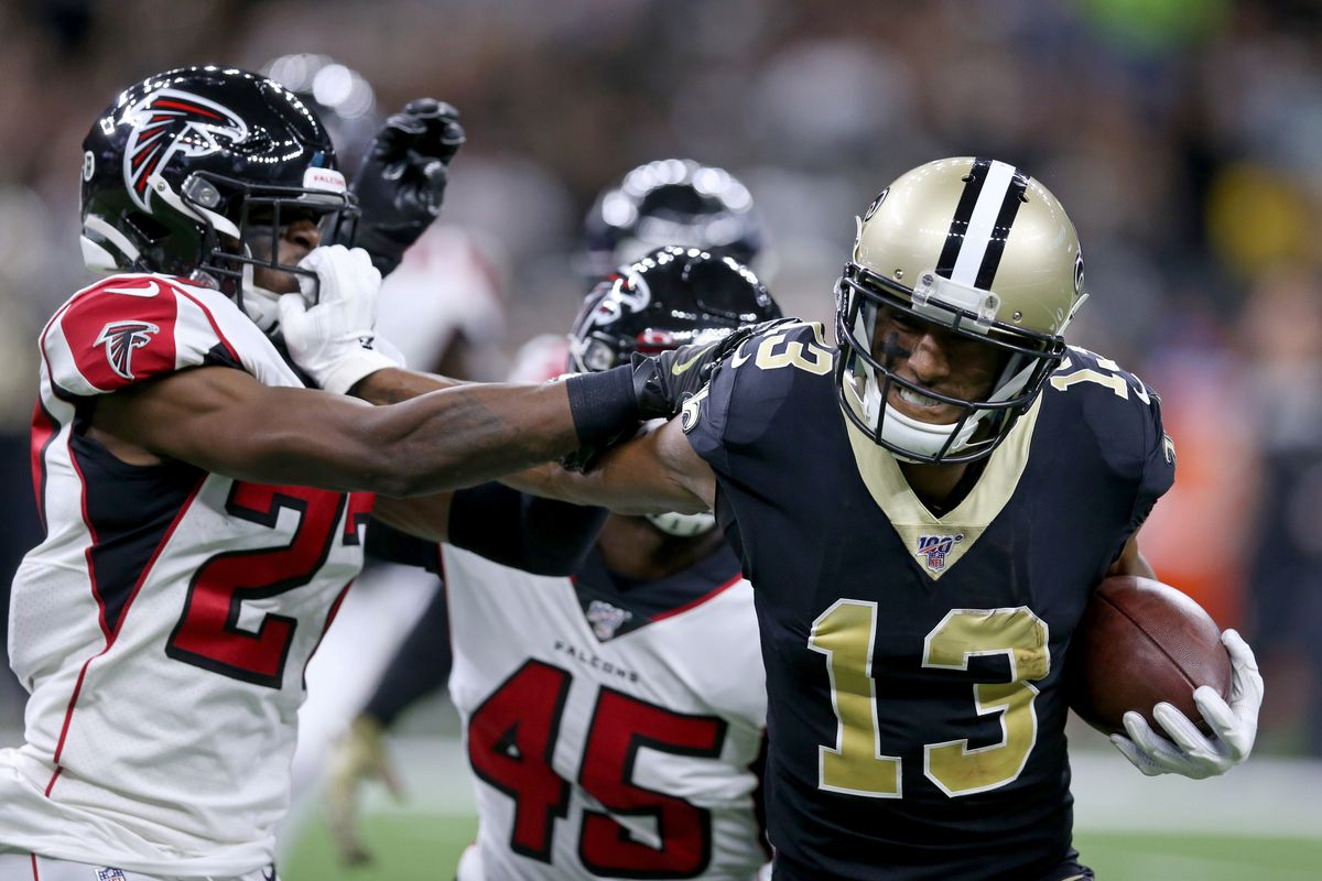 pushes Atlanta Falcons strong safety Damontae Kazee away by his facemark in the second quarter at the Mercedes-Benz Superdome. Thomas was called for a facemask penalty.