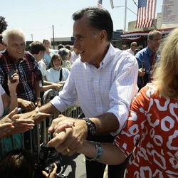 Republican presidential hopeful, Mitt Romney and his wife, Ann, greet supporters during a campaign stop at the Hires Big H on 700 East and 400 South in Salt Lake City Friday, June 24, 2011.